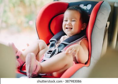 a baby sit in the car seat for safety.