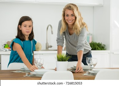 baby sitter and young girl in the kitchen