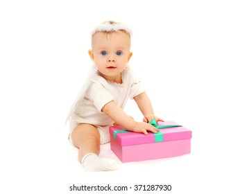 Baby sitting with gift box on a white background