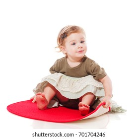 Baby sitting on floor isolated on white
