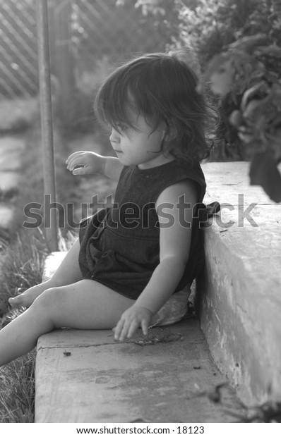 baby sitting on porch