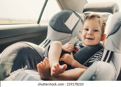 baby sitting in safety car seat