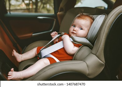 Baby sitting in safety rear-facing car seat family lifestyle vacation road trip child security transportation