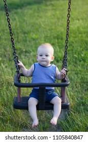 Baby sitting in swing