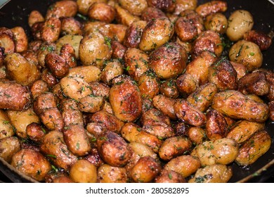 Baby skinned potatoes on pan with dill and fried