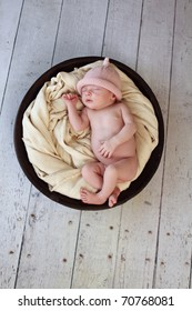 Baby sleeping in a bowl