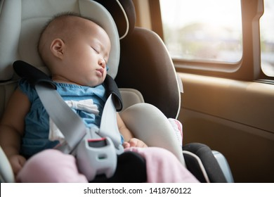 Baby sleeping in child car seat.