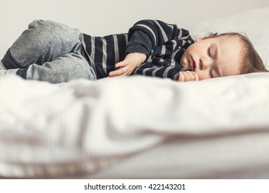 Baby sleeping in his bed.