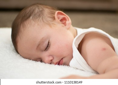 Baby sleeping long hour after had vaccination on his shoulder