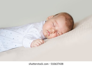 Baby sleeping on the white bed