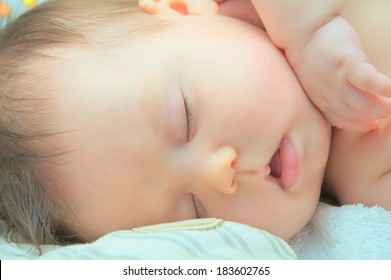 baby sleeping portrait at night, cute and adorable newborn baby face closeup