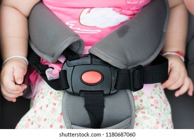 Baby sleeping in stroller outdoor. Seat belt in a baby carriage.Close up Concept Safety and health of children. View from above
