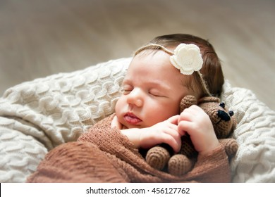 Baby sleeping sweetly in a basket