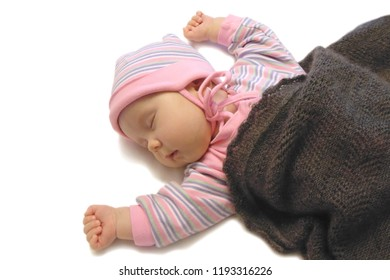 the baby is sleeping sweetly smiling, wrapped in a blanket. the establishment of sleep in the baby