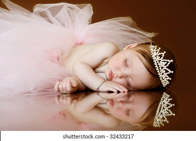 baby sleeping with tutu and crown