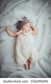 Baby sleeping while wearing a hat