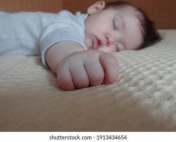 baby sleeps on the bed