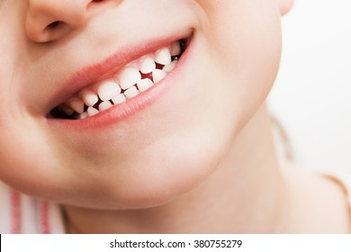 baby smile close. white teeth of a child isolated on a white background