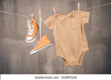 Baby sneakers and onesie