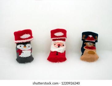Baby socks with Christmas motiveon white fleece