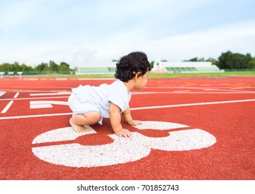 Baby start crawling on runner lane