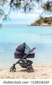 baby stroller by the sea
