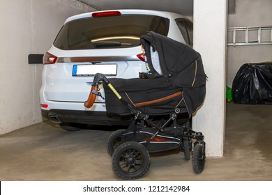 Baby stroller and car in a garage