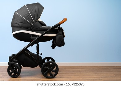 Baby stroller indoor. Empty place for text. Front view.