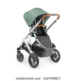Baby Stroller Isolated on White Background. Side View of Travel System with Green Melange Canopy and Swivel Front Wheels. Infant Carriage Seat. Pushchair or Pram with Adjustable Showerproof Hood