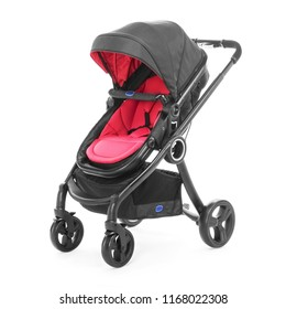 Baby Stroller Isolated on White Background. Side View of Black and Red Travel System with Canopy and Swivel Front Wheels. Infant Carriage Seat. Pushchair or Pram with Adjustable Showerproof Hood