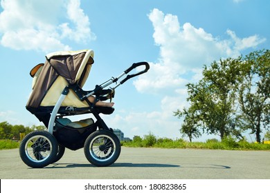 baby stroller on a walk in the park summer day