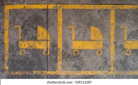 Baby stroller parking sign on concrete street