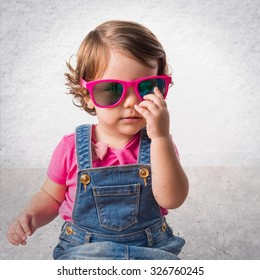 Baby in studio with sunglasses