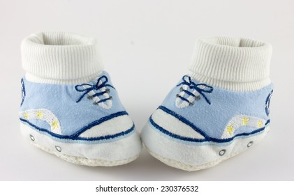 Baby stuff and shoes isolated on white