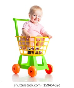 baby in a supermarket trolley on a white background isolated