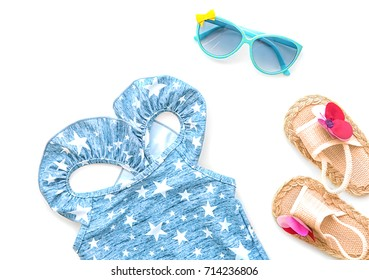 Baby swimsuit, sunglasses and sandals, isolated on white