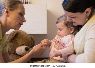 Baby at therapist physio healing massage. wellness and spa for the body. shiatsu relaxing for kids and care the children