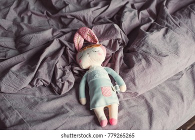 Baby toy bunny on the bed. Children's room.
