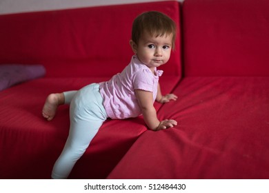 baby with a toy, concept early development, fine motor skills. Cozy house, lifestyle, selective focus, toning