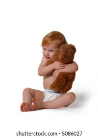 baby with toy isolated in white