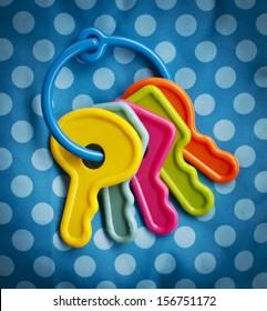 Baby toy keys over a polka dot background