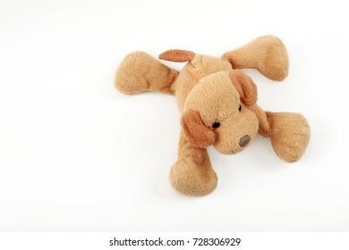baby toy soft dog, isolated on white background,  lying, smile, beige dog, design element, children's postcard