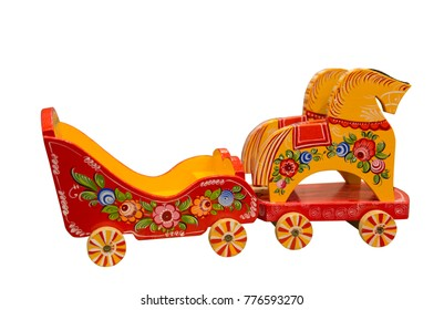 Baby toy wagon pulled by two horses. Russian folk arts and crafts. Arkhangelsk region, Russia