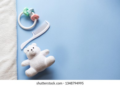 baby toys on blue background with copy space. Top view or flat lay.