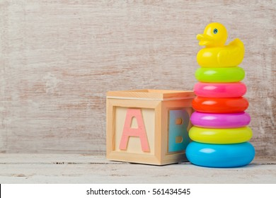 Baby toys on wooden table. Child development concept