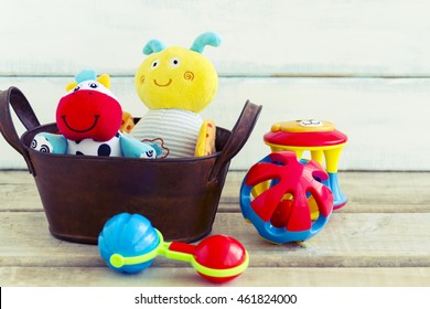 Baby toys, toddler toys or infant toys including stuffed animals and rattles in a gift basket