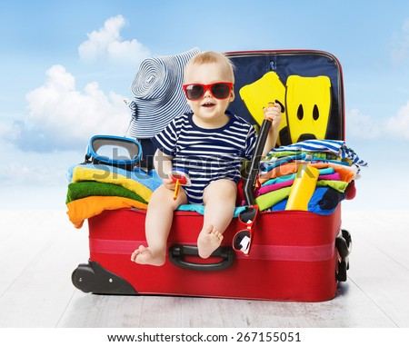 Baby in Travel Suitcase. Kid inside Luggage Packed for Vacation Full of Clothes, Child and Family Trip