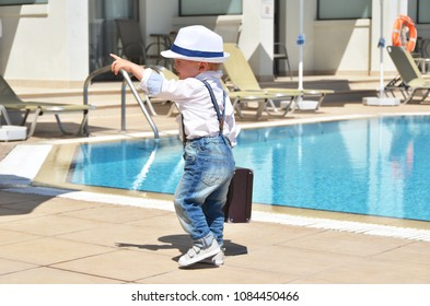 Baby traveler with a suitcase