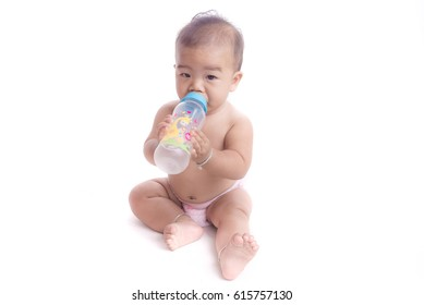 baby tries to suck milk from the bottle.