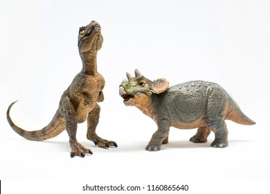 Baby tyrannosaurus rex and baby triceratops on white background